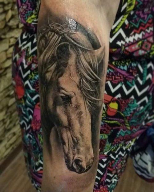 Two guns tattoo bali